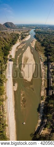 Aerial View Of Kok River In Dry Season Nearly Chiang Rai Beach, A River Bank With Rocky Shores View.