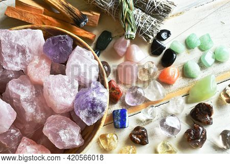A Top View Image Of A Bowl Of Rose Quartz Crystals With Several Other Healing Crystal And Smudge Sti