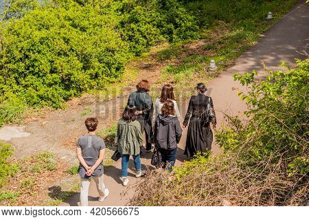 Daejeon, South Korea; May 2, 2021: Group Of Unidentified Women Walking On Asphalt Path In Wilderness