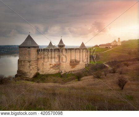 Ancient Fortress In Khotin. Castle In Ukraine. A Majestic Fortification On The Banks Of The River.