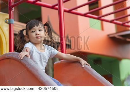 Portrait Image Of 3-4 Years Old Childhood. Happy Asian Child Girl Playing With The Slider Bar Toy At