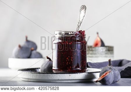 Sweet Red Fig Jam Jar. Fresh Blue Figs. Homemade Preparations And Canning. Gray Table Background, Co