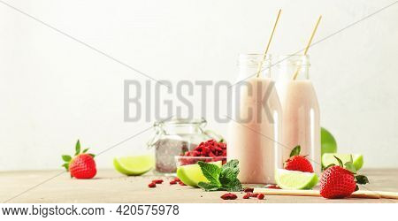 Healthy Blended Diet Smoothie Drink With Strawberry And Goji Berries, Chia Seeds And Lime. Glass Bot