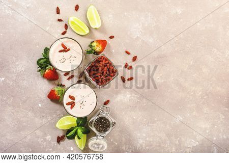 Healthy Blended Diet Smoothie Drink With Strawberry And Goji Berries, Chia Seeds And Lime. Top View