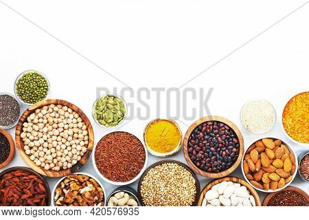 Set Of Superfoods, Legumes, Cereals, Nuts, Seeds In Bowls On White Background. Superfood As Chia, Sp