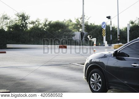 Black Car Accessing To Open Gate And Entrance And Exit From Village , Security And Safety Concept.
