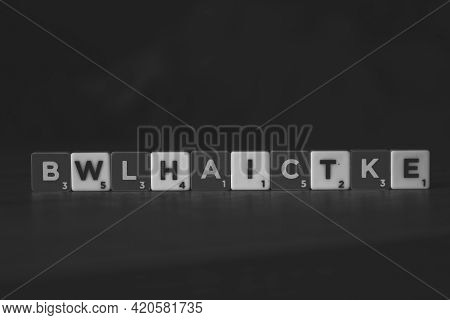 Brecht, Belgium - 28 July 2020: A Portrait Of Black And White Scrabble Letters, Which Are Mixed, But
