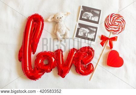 Flat Lay Composition With Baby Accessories On White Bed Background. Concept Of Awaiting Baby, Pregna