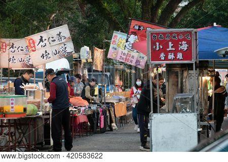 Taichung, Taiwan - Jan 13th, 2021: night marketplace with vendor and people shop at Puli town, Nantou, Taiwan