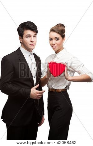 young happy business people holding red Valentine