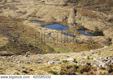 Coum Tay Lakes Seen From The Edge Of The Comeragh Plateau  In County Waterford, Ireland.