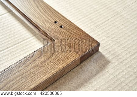 Wooden Frame For Furniture Facade With Input Hole For Handles On Cardboard Box In Carpentry Workshop