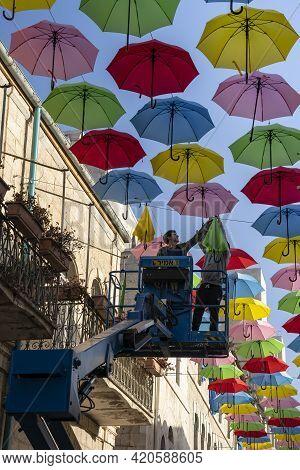 Jerusalem, Israel - April 29th, 2021: Municipal Employees Use A Crane Lift To Hang Colorful Decorati