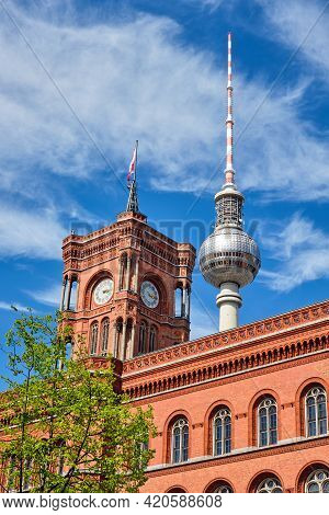 The Famous Television Tower And The Tower Of The City Hall In Berlin