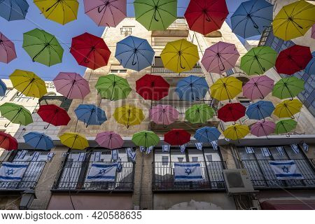 Jerusalem, Israel - April 29th, 2021:colorful Decorative Umbrellas And Israel's National Flags Decor