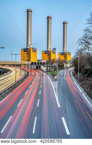 Highway And  Power Station At Dusk Seen In Berlin, Germany