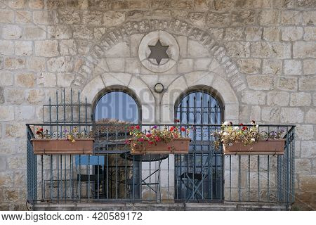 A Typical Balcony In The Jewish Houses Of Old Jerusalem, With Arched Doors, Decorated With A Star Of
