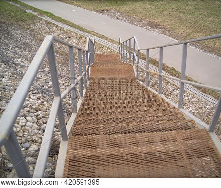 Descent Of The Embarkment With Metal Grilled Steps, Outdoor Shot