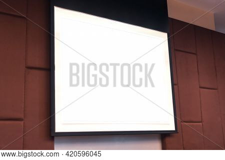 Seminar Room With Blank Projector Empty White Screen For Presentation In Conference Or Meeting Room,