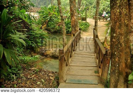 Small Wooden Bridge Crossing Stream Creek For Laotian People And Foreign Traveler Walking Travel Vis
