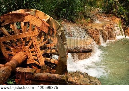 Wooden Water Turbine At Outdoor In Forest Of Tat Kuang Si Waterfalls Or Kuang Xi Falls For Laotian P