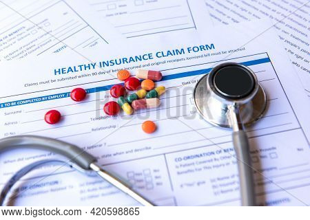 Health Insurance For Healthy Care Form And Protection People Life With Stethoscope And Medicine.  h