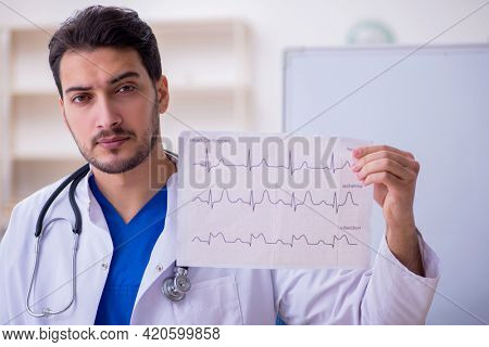 Young male doctor cardiologist in the classroom