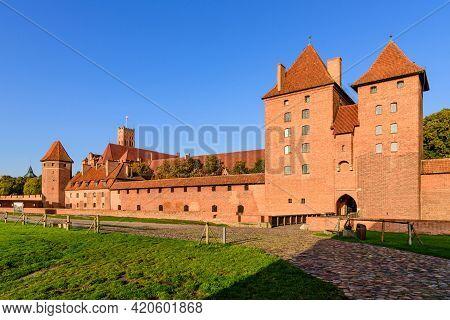 Malbork, Poland - October 9, 2019: Sightseeing Of Poland. Medieval Castle In Malbork Town, A Popular