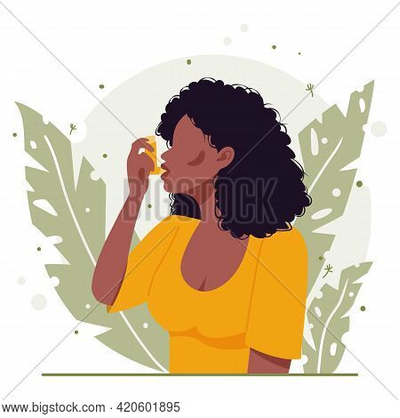 Young Black African American Woman With Black Curly Hair Uses An Asthma Inhaler Against An Allergic