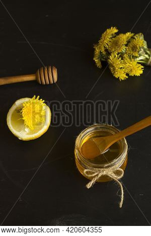 Homemade Delicious Dandelion Jam On A Black Table With Yellow Dandelions. Dandelion Flower Syrup. Us