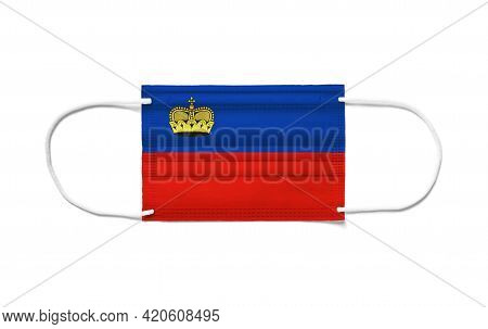 Flag Of Liechtenstein On A Disposable Surgical Mask. White Background Isolated