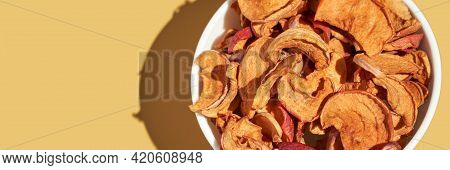 Crispy Dried Food. Organic Tasty Chips. Homemade Snacks. Sliced Apples. Healthy Fruit. Crispy Dried