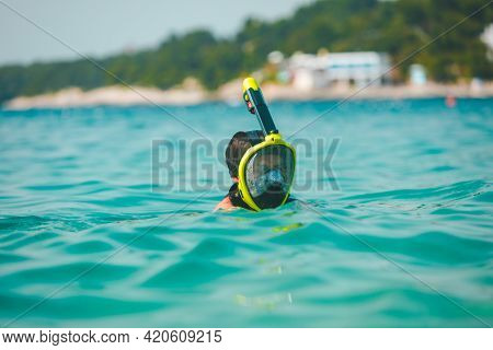 Woman In Snorkeling Mask In Sea Water