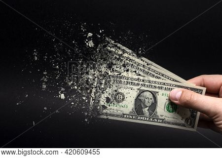 Inflation, Dollar Hyperinflation With Black Background. One Dollar Bill Is Sprayed In The Hand Of A
