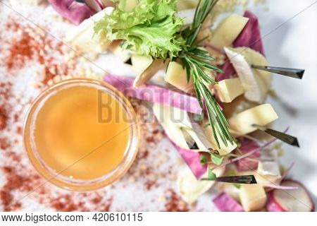 Set Of Cheese Decorated With Herbs And Honey, Top View. Banquet Table With Delicious Food In A Resta