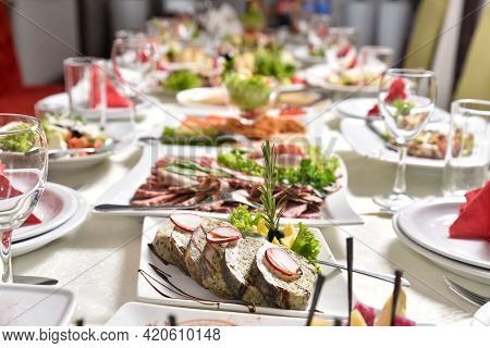 Banquet Table With Delicious Food In A Restaurant. Professional And Exquisite Dish Serving At Restau