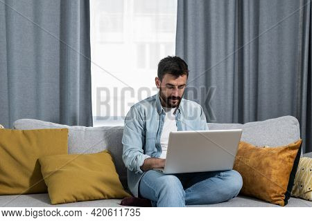 Young Freelancer Business Man Typing On His Laptop Computer An E Mail With His Cv As Job Offer To Bu