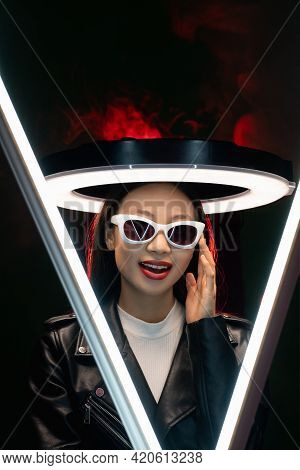Tech Fashion. Cyberpunk People. Eyewear Accessories. Red Neon Light Art Portrait Of Smiling Asian Gi