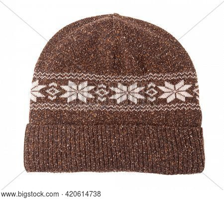 Brown knitted winter beanie hat decorated with Scandinavian geometric ornament isolated on white background