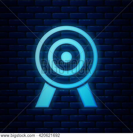 Glowing Neon Target Icon Isolated On Brick Wall Background. Dart Board Sign. Archery Board Icon. Dar