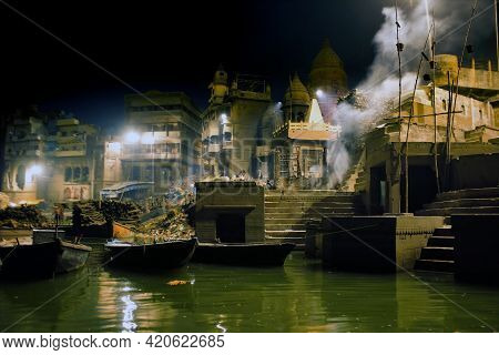 Night Wide Angle Shot At The Cremation Ghats In The Sacred Town Of Varanasi Hindus Burn The Dead Peo