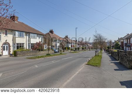 Sheffield, South Yorkshire, England - April 19 2021: A Suburban Street Of Houses  In Sheffield Engla
