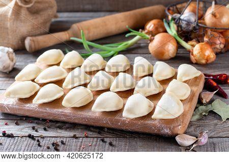 Homemade Dumplings - Russian Dumplings. Meat Dumplings, Ravioli. Dumplings With Stuffing.