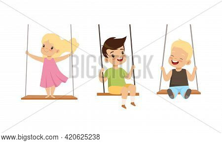 Set Of Happy Kids Swinging On Rope Swings, Preschool Children Having Fun Outdoors Cartoon Vector Ill