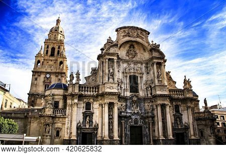 Tower Bell, Carved Stone Details And Entrance Gate Of The Main Facade Of The Cathedral Of Murcia.