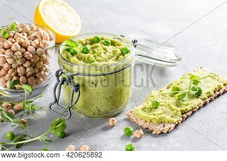 Green Parsley Hummus With Chickpeas, Green Pea And Homemade Chickpeas On A Table. Delicious Healthy