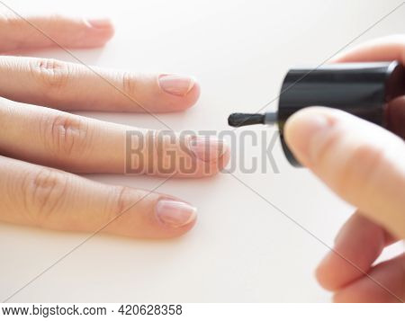 Applying A Colorless Base To The Nail. Manicure At Home, Nail Care.