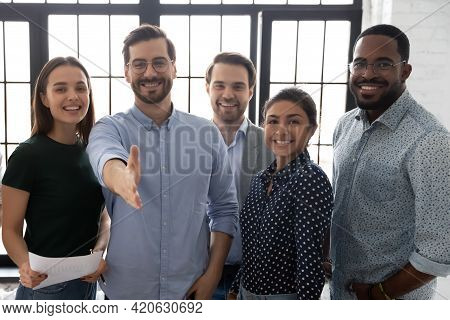 Happy Millennial Business Group Leader Giving Hand For Shake
