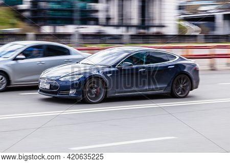 Tesla Model S On The City Road. All Electric Five Door Liftback Sedan In Motion On The Street. Mosco