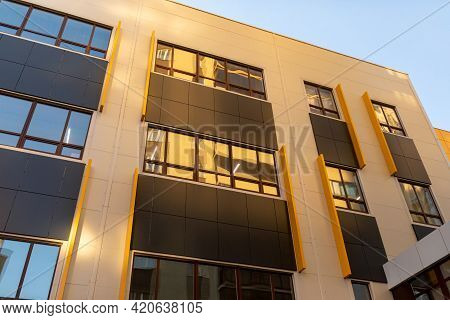 Beige And Brown Modern Ventilated Facade With Windows. Fragment Of A New Elite Residential Building